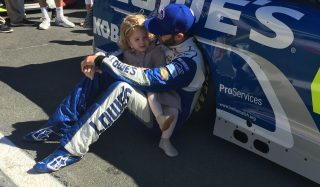 Jimmie Johnson spending some special family time before the fall race at Charlotte Motor Speedway that Johnson went on to win. (Photo: Dustin Long)