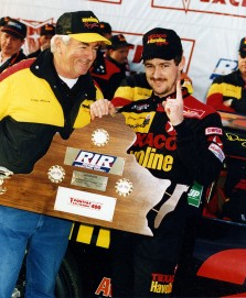 RICHMOND, VA ? March 7, 1993: Bobby Allison (L) joins his son, Davey Allison, in victory lane at Richmond International Raceway after Davey won the Pontiac Excitement 400 NASCAR Cup race. It would be the younger Allison?s final Cup victory. (Photo by ISC Images & Archives via Getty Images)
