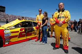 BROOKLYN, MI - JUNE 12: (L-R) Joey Logano, driver of the #22 Shell Pennzoil Ford, wife Brittany Logano and crew chief Todd Gordon stand on the grid prior to the NASCAR Sprint Cup Series FireKeepers Casino 400 at Michigan International Speedway on June 12, 2016 in Brooklyn, Michigan. (Photo by Todd Warshaw/Getty Images )
