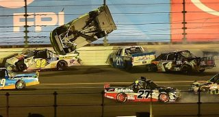 DAYTONA BEACH, FL - FEBRUARY 24: Matt Crafton, driver of the #88 Goof Off/Menards Toyota, flips during the NASCAR Camping World Truck Series NextEra Energy Resources 250 at Daytona International Speedway on February 24, 2017 in Daytona Beach, Florida. (Photo by Jared C. Tilton/Getty Images)